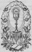 image of the Chalice and the Host with the Bible in front